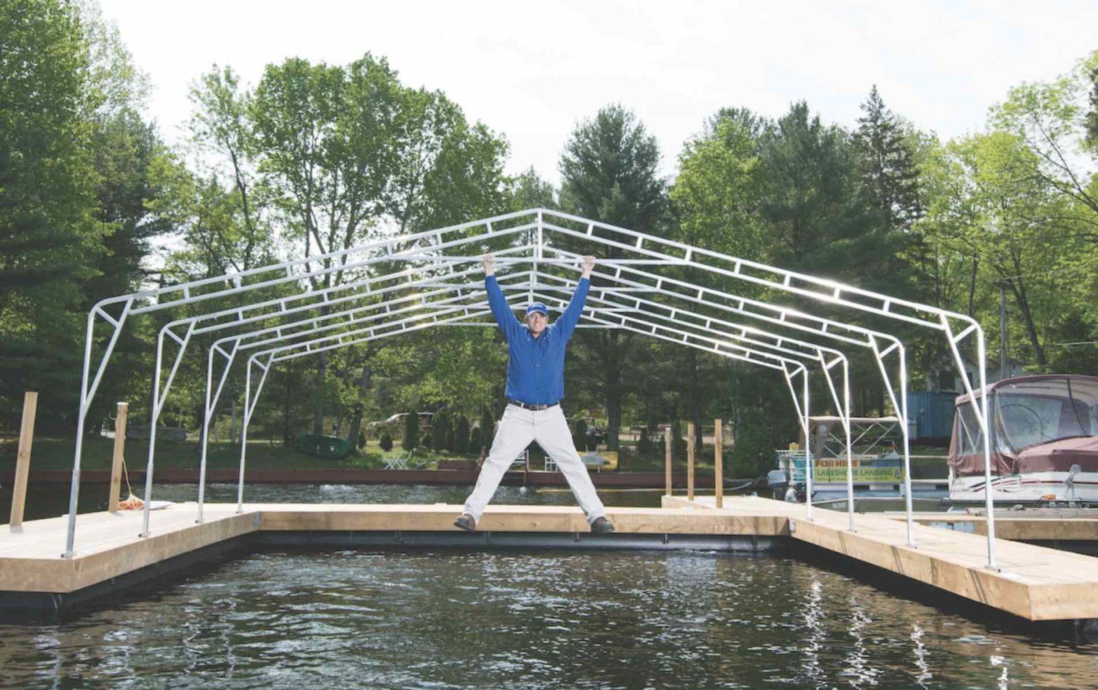 Aquadome made-in-Muskoka awnings with man hanging over water